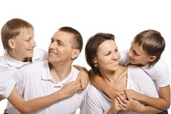 Familie van vier op wit Royalty-vrije Stock Afbeeldingen