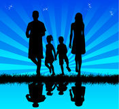 Familie in water - bezinning Royalty-vrije Stock Foto's