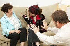 Familien-Beratung - Schuld-Mamma Stockfotos