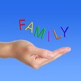 Familienbuchstabe und -hand Lizenzfreies Stockfoto