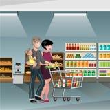 Familieneinkaufen mit Warenkorb Stockbild