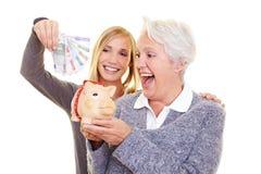 Familieneinsparunggeld für Rentenbezug Stockbild