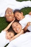 Familienlächeln Stockfotos