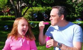 Familienluftblasen stockbild