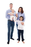 Familienporträt - Vater, Mutter, Tochter und Sohn lokalisiert auf w Lizenzfreie Stockbilder