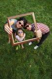 Familienrahmen lizenzfreie stockbilder