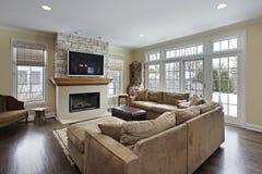Familienraum mit Kamin Stockbilder