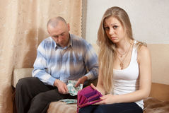 Familienstreit über Geld Stockbild