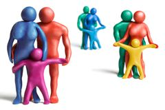 Families. Multicolored plasticine human figures on a white background Royalty Free Stock Photo