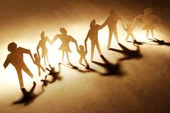 Families. Holding hands on brown background Royalty Free Stock Photography