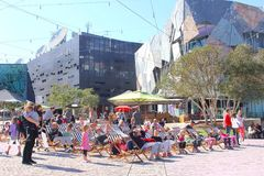 Families beach chairs, Federation Square, Melbourne Royalty Free Stock Photo