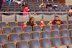 Families with children in the auditorium l Royalty Free Stock Photos