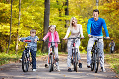 Families with children on bicycles Stock Photo