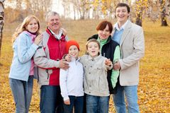 Big family in autumn park Royalty Free Stock Photo