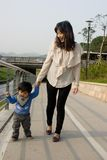 Families Chinese. Boy is learning to walk with his mom Royalty Free Stock Photo