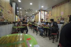 Families enjoy their dinners at a restaurant in Kowloon, Hong Kong.  stock photos