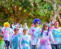 Families Enjoying Color Frenzy Fun Run. MACKAY, QUEENSLAND, AUSTRALIA - JUNE 2019: Unidentified costumed families enjoying themselves in Color Frenzy Fun Run royalty free stock photography