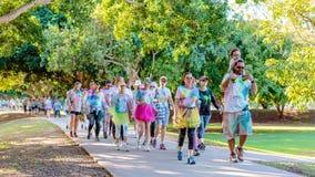 Families Enjoying Color Frenzy Fun Run. MACKAY, QUEENSLAND, AUSTRALIA - JUNE 2019: Unidentified families out and about outdoors enjoying Color Frenzy Fun Run royalty free stock photos
