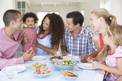 Families Enjoying Meal Together At Home Stock Images