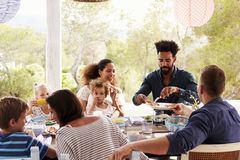 Families Enjoying Outdoor Meal On Terrace Together stock photos