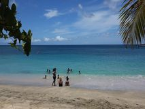 Families enjoying the sea at lower bay, bequia stock footage