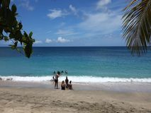 Families enjoying the sea at lower bay, bequia stock video footage