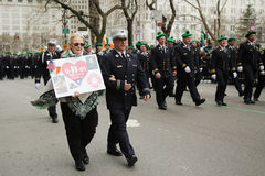 Families of the fallen FDNY firefighters who lost life at World Trade Center marching at the St. Patrick's Day Parade stock photos