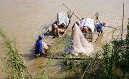 Families of fisherman do fishing on rive Stock Images