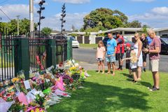 Families at a floral tribute to the Christchurch mosque attacks. Tauranga, New Zealand - March 16 2019: Local residents gather at Tauranga mosque in a show of stock photography