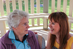 Families. A grandmother and grand daughter share a special moment together Royalty Free Stock Images