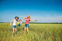 Families have fun in the field. Three families have fun in the field royalty free stock image