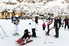 Families on holiday on the slopes of the Italian Alps. Stock Photo