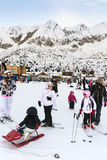 Families on holiday on the slopes of the Italian Alps. Stock Photos
