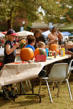 Families And Kids Carve and Paint Halloween Pumpkins Royalty Free Stock Image