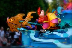 Pixar Disney Parade Little Mermaid. Families line up the sidewalks to view Disney Parade floats from Little Mermaid Pixar animated film stock photography