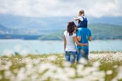 Families in Nature. The women, men and child have fun relaxing outdoors, close-knit family Royalty Free Stock Images