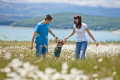 Families in Nature. The women, men and child have fun relaxing outdoors, close-knit family Royalty Free Stock Photo