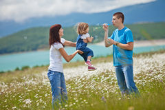 Families in Nature. The women, men and child have fun relaxing outdoors, close-knit family Royalty Free Stock Image