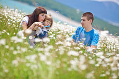Families in Nature. The women, men and child have fun relaxing outdoors, close-knit family Royalty Free Stock Photos