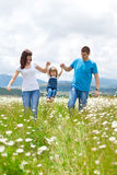 Families in Nature. The women, men and child have fun relaxing outdoors, close-knit family Stock Photos