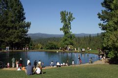 Families at the Park Fishing. People at a pond fishing in the Sierra Nevada foothills Royalty Free Stock Photography