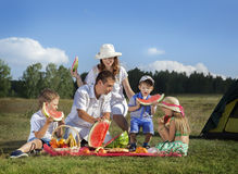 Families picnic outdoors. With food stock photo