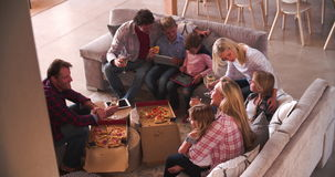Families Relaxing On Sofas With Takeaway Pizza And Wine stock video footage