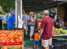 Families at the Salem Farmers Market. Salem, Virginia USA – July 28th: Families enjoy a morning at Salem Farmers Market on a Saturday morning located in Stock Photos