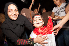 The Families sharing Egyptian revolution Stock Photos