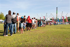 Families Stand In Long Line Waiting For Atlanta Festival Ride Royalty Free Stock Images