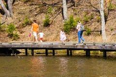 Families Walking at Pandapas Pond Royalty Free Stock Images