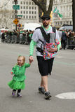 Families with young kids marching at the St. Patrick's Day Parade in New York Royalty Free Stock Photos