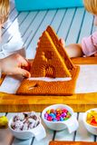 Familiy building a sweet ginger bread house royalty free stock photography