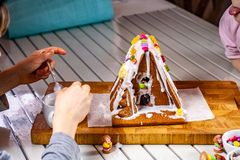 Familiy building a sweet ginger bread house royalty free stock images